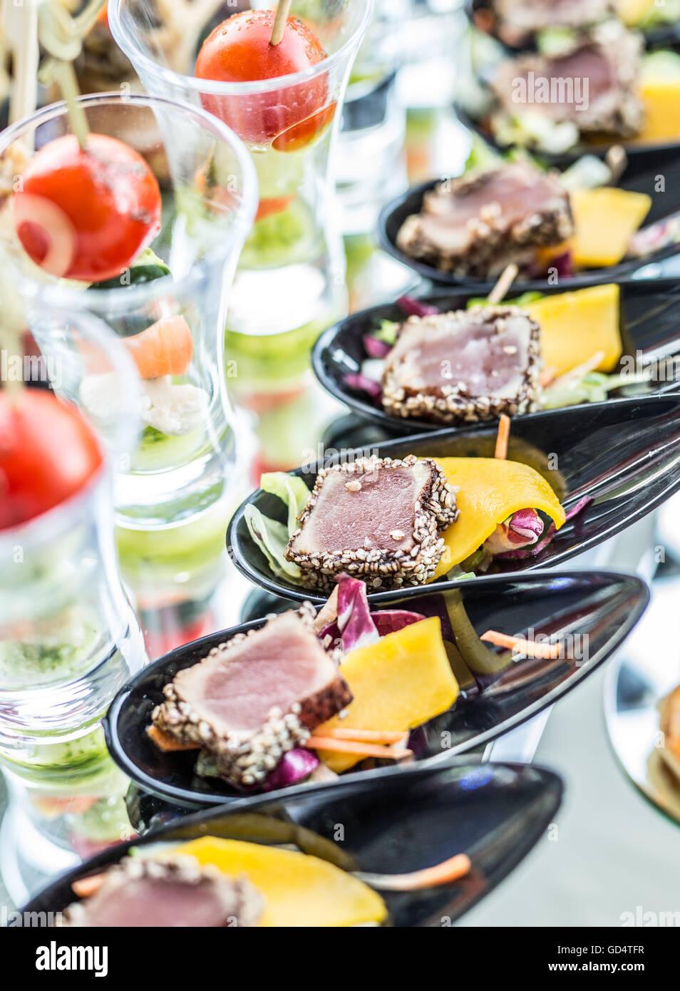 Assortment of canapés. Banquet service. Stock Photo