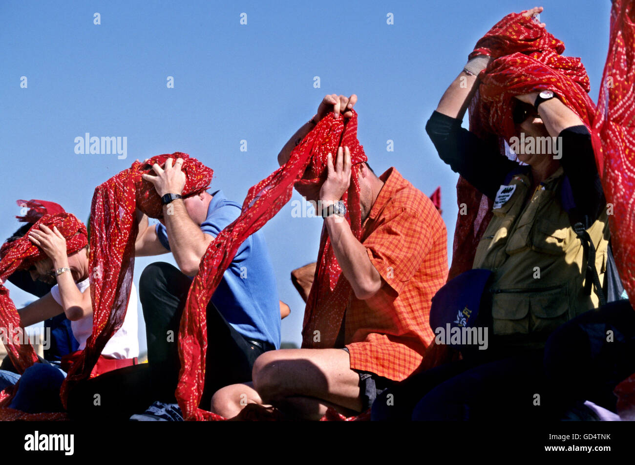 Foreigners in a turban tying competition - Stock Image
