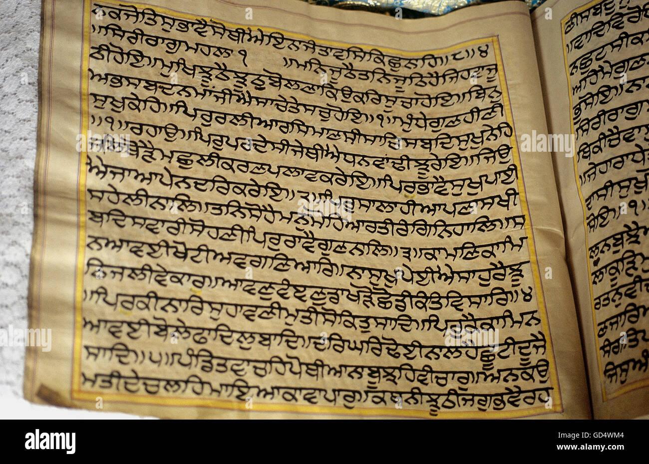 Hand written Guru Granth Saheb - Stock Image