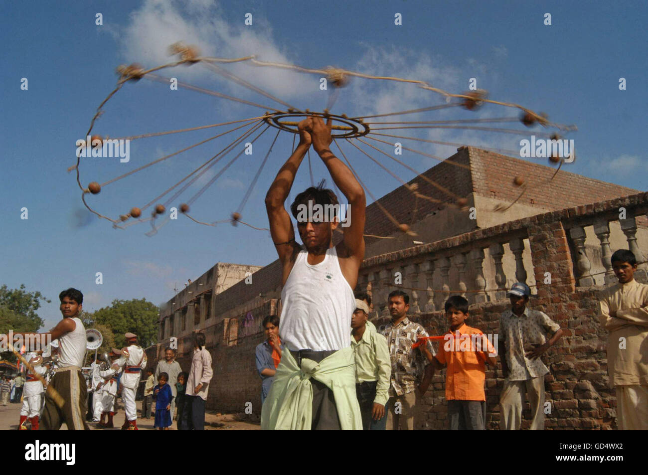 A boy rotates the rope wheel - Stock Image