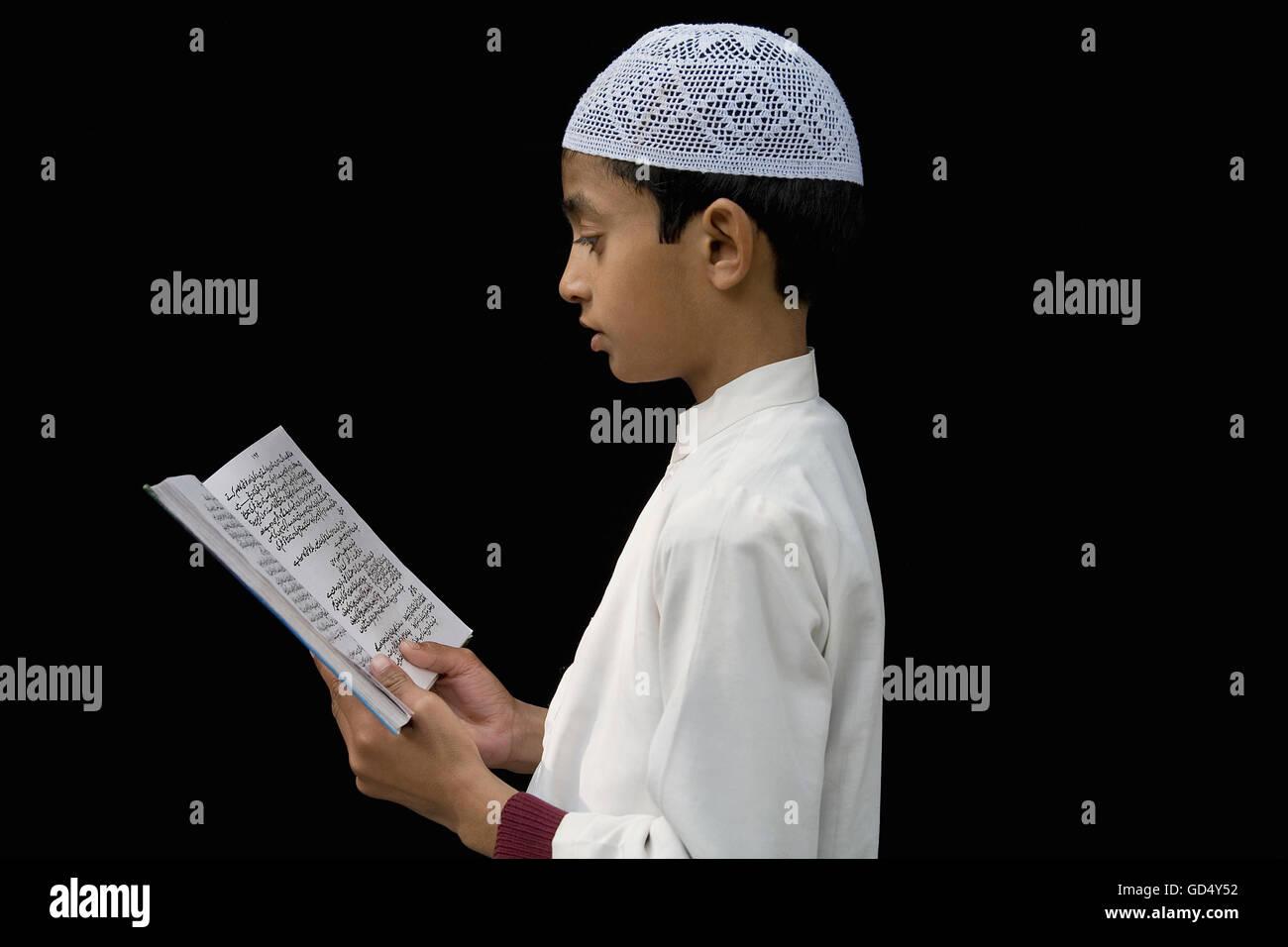 Boy Reading Quran - Stock Image