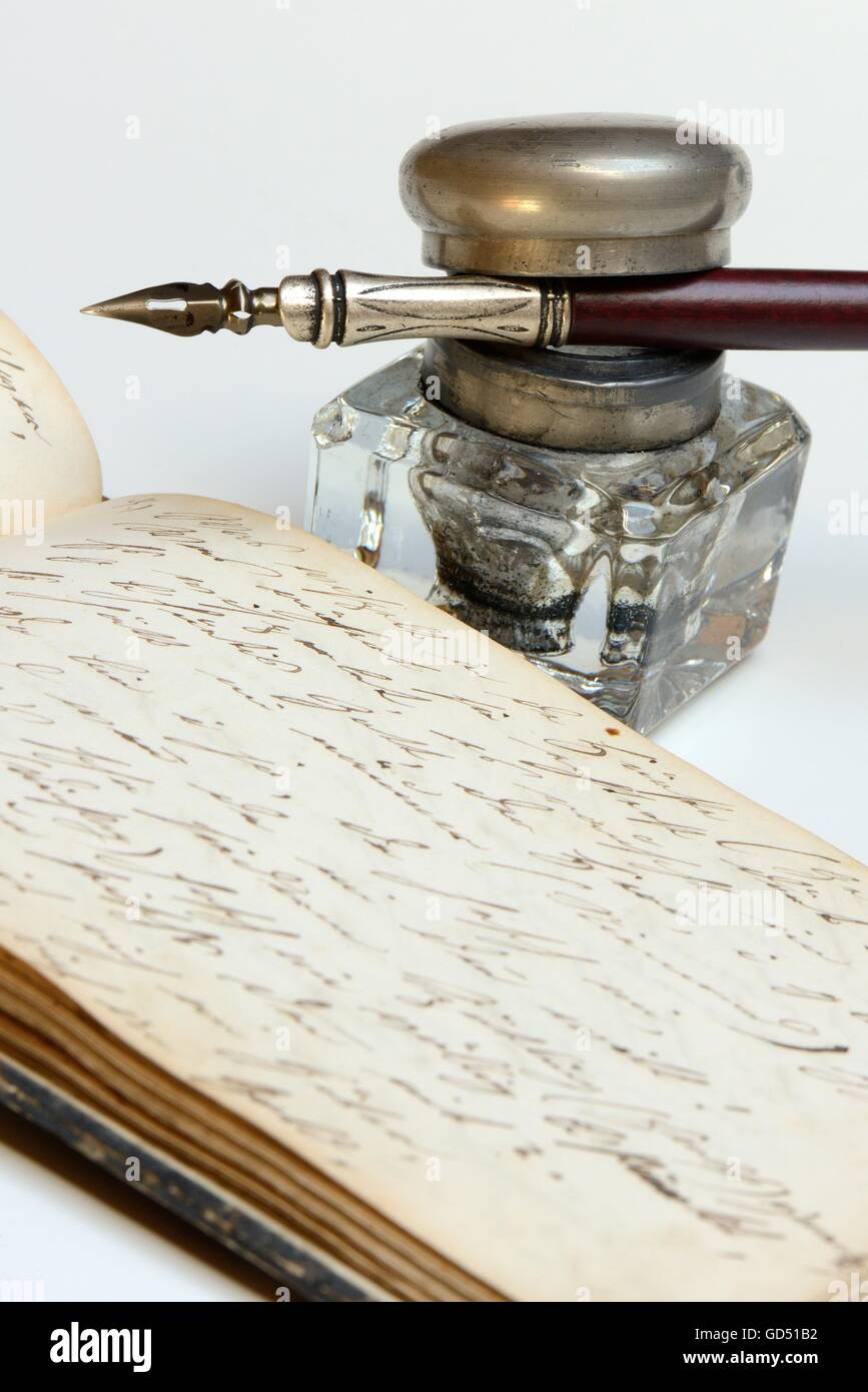 dip pen, old diary with handwriting - Stock Image