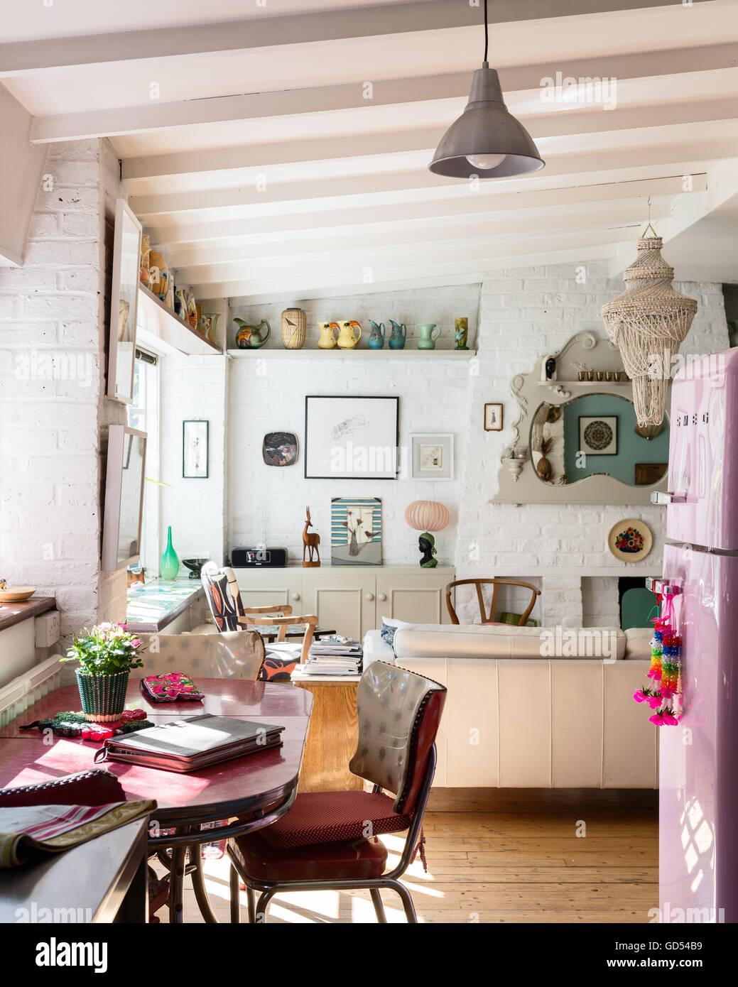 Open plan kitchen living area with retro pink Smeg fridge Stock ...