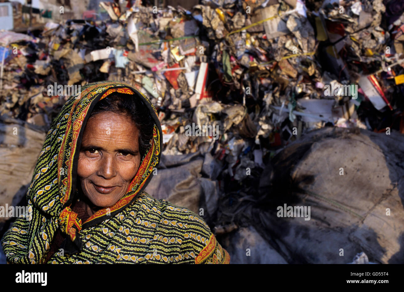 A female rubbish recycler - Stock Image