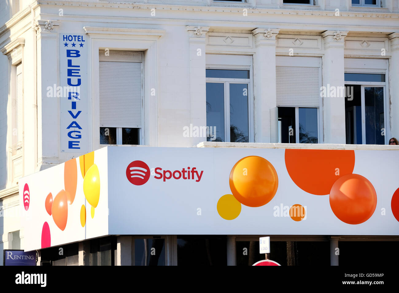 The Spotify Office building in Cannes France. The premises hoardings are decorated in the music streaming services - Stock Image