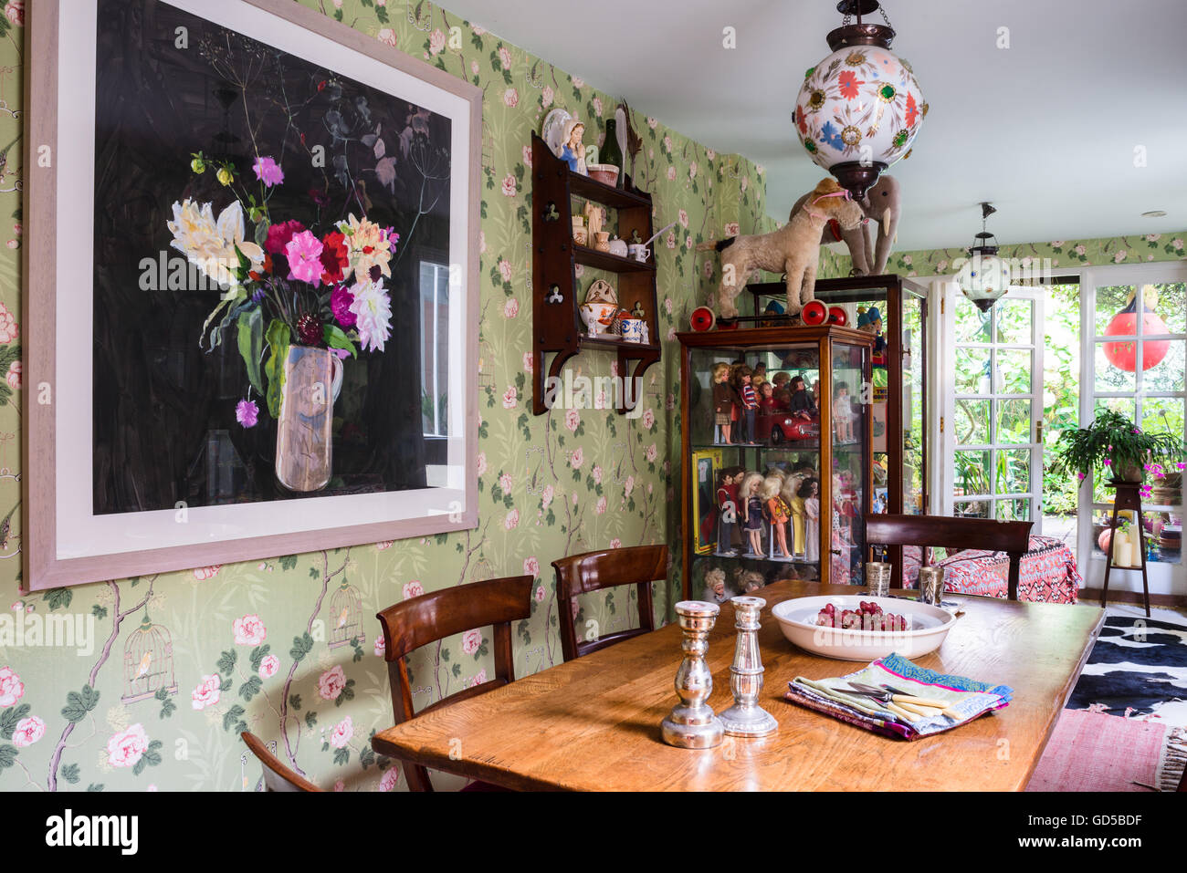 Songbird wallpaper designed by Mark Rochester for GP & J Baker in dining room with Rochester painting, Arts - Stock Image