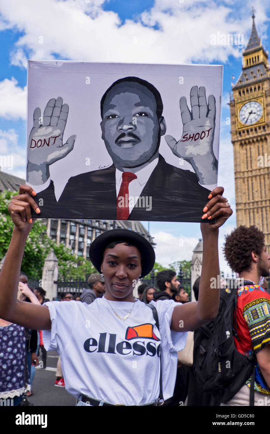 """Black Lives Matter""  Over a thousand people marched through London chanting 'hands up don't shoot'. - Stock Image"