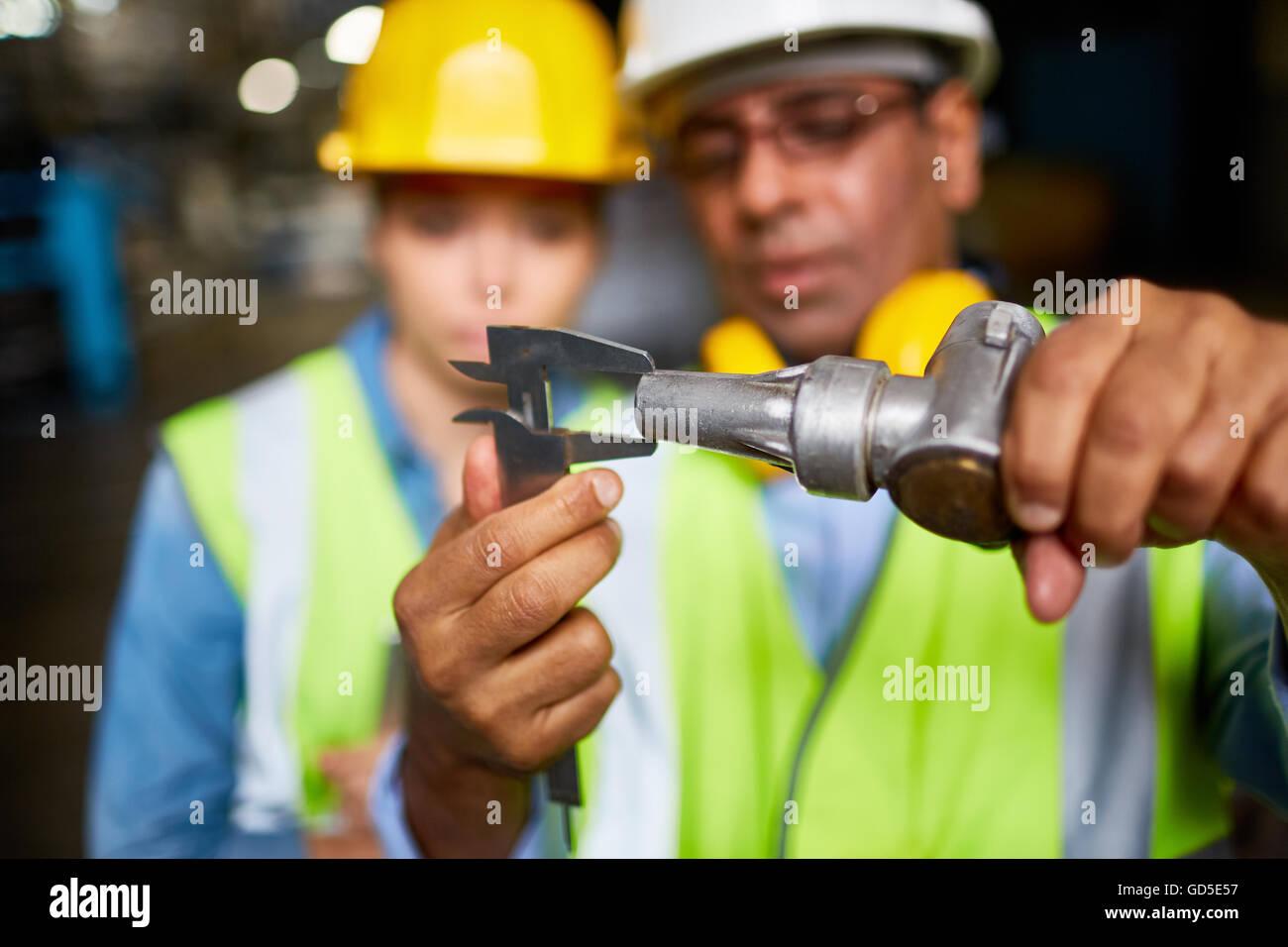 Measuring metallic part - Stock Image
