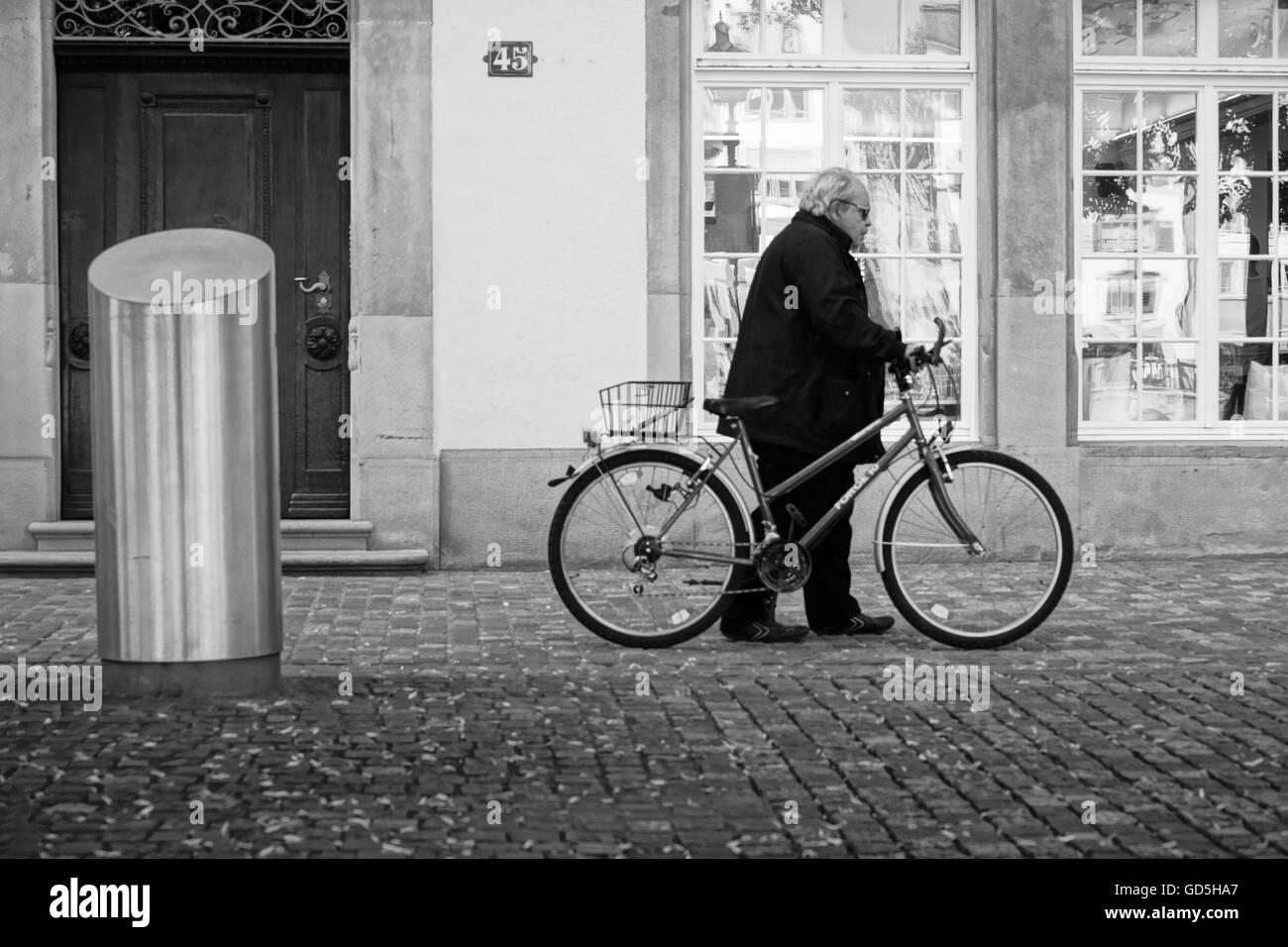 Old man with bicycle in zurich, switzerland, europe - Stock Image