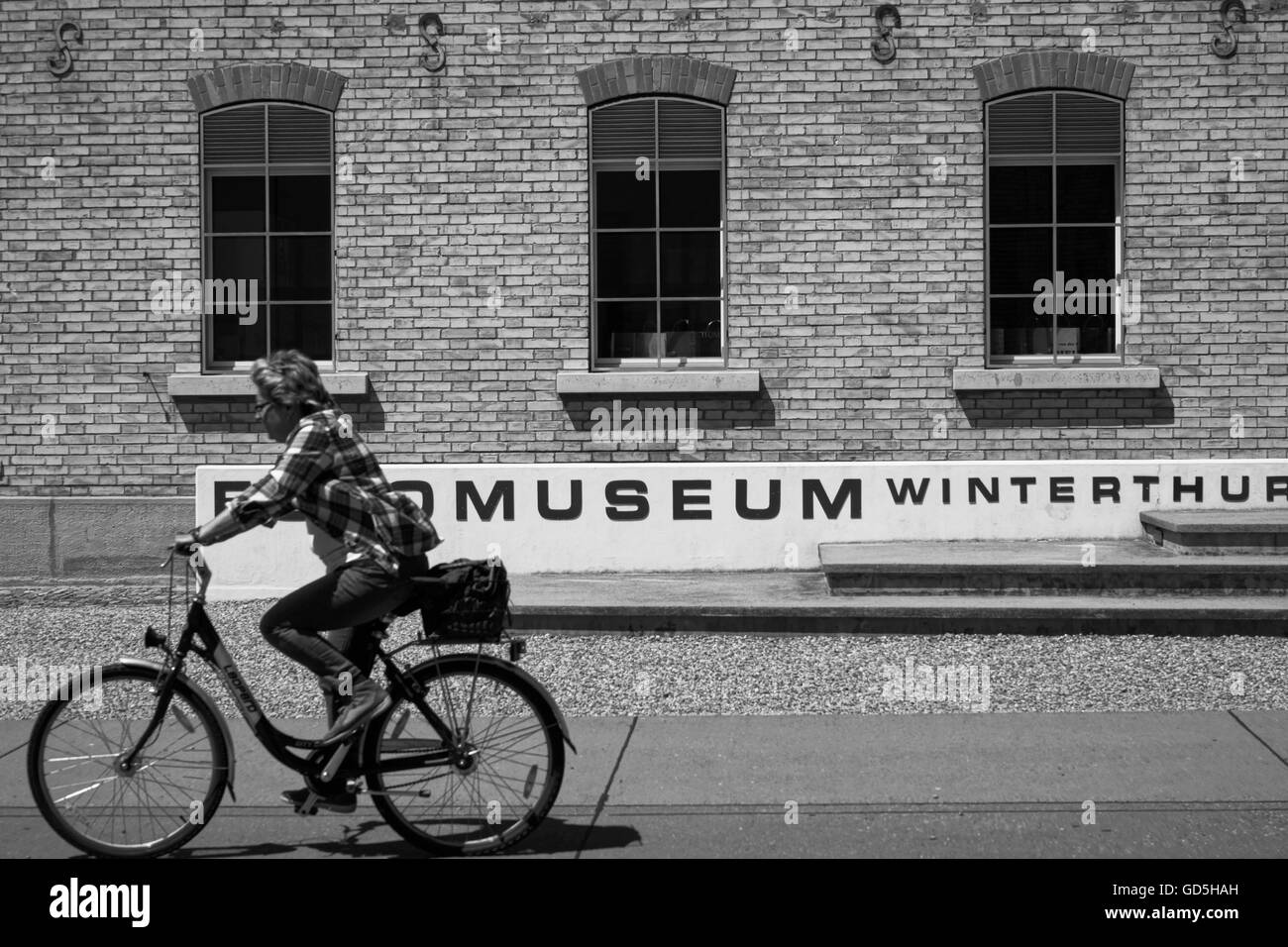 Bicycle rider in front of fotomuseum winterthur, zurich, switzerland, europe - Stock Image