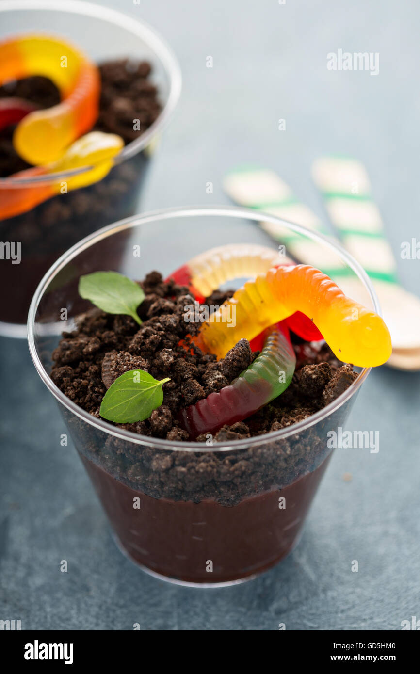 Children chocolate dessert in a cup dirt and worms - Stock Image