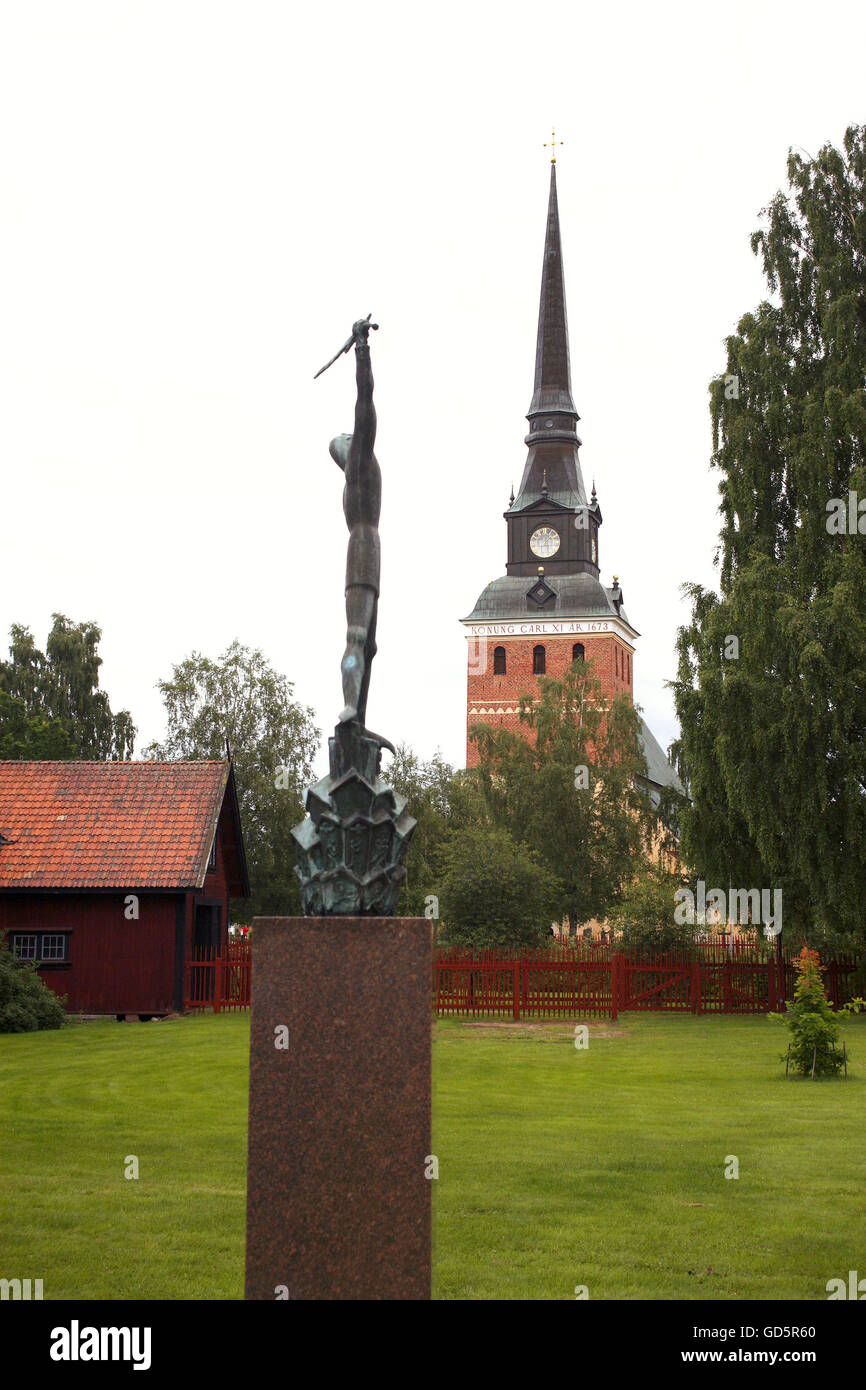 A sculpture with the church in the fund - Stock Image