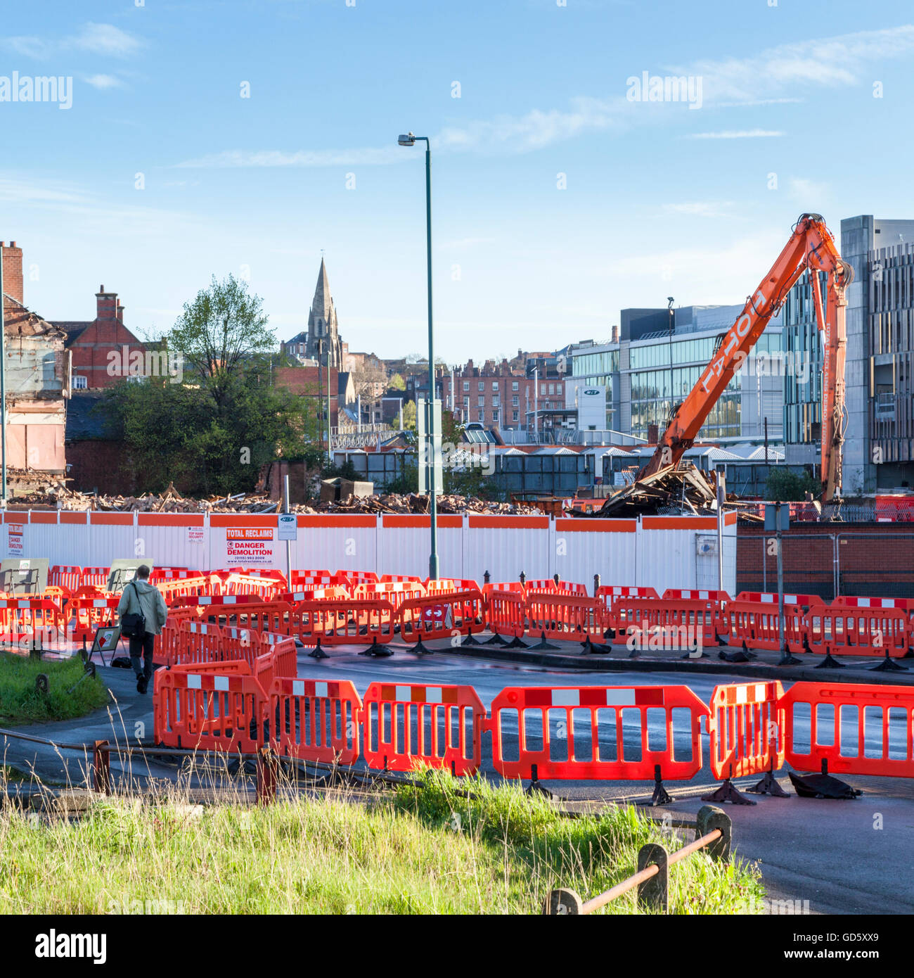 Safety barriers near buildings being demolished, Nottingham, England, UK - Stock Image