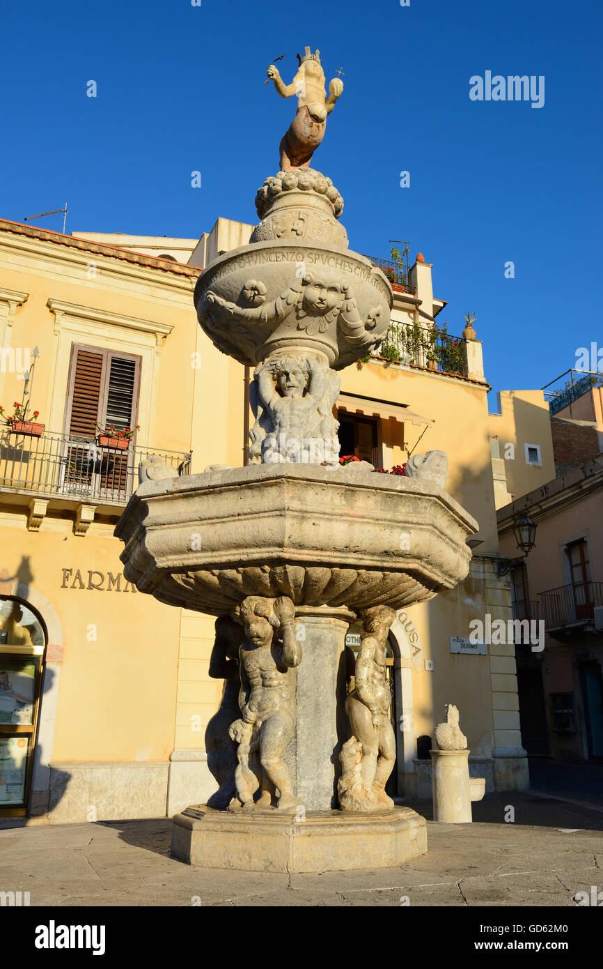 Baroque fountain in Piazza del Duomo at sunrise - Taormina, Sicily, Italy - Stock Image