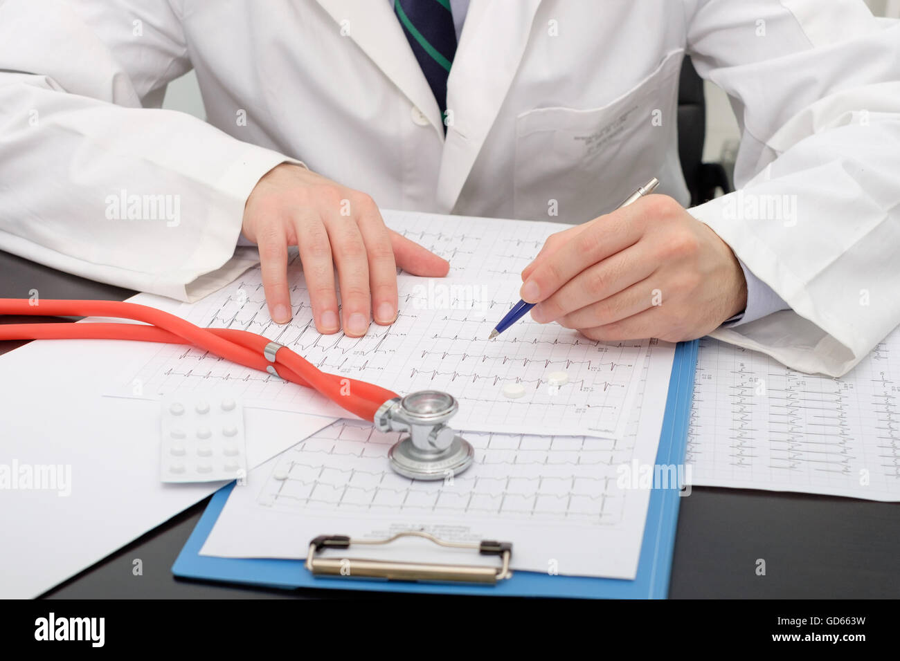 Doctor checking an Ecg paper - Stock Image