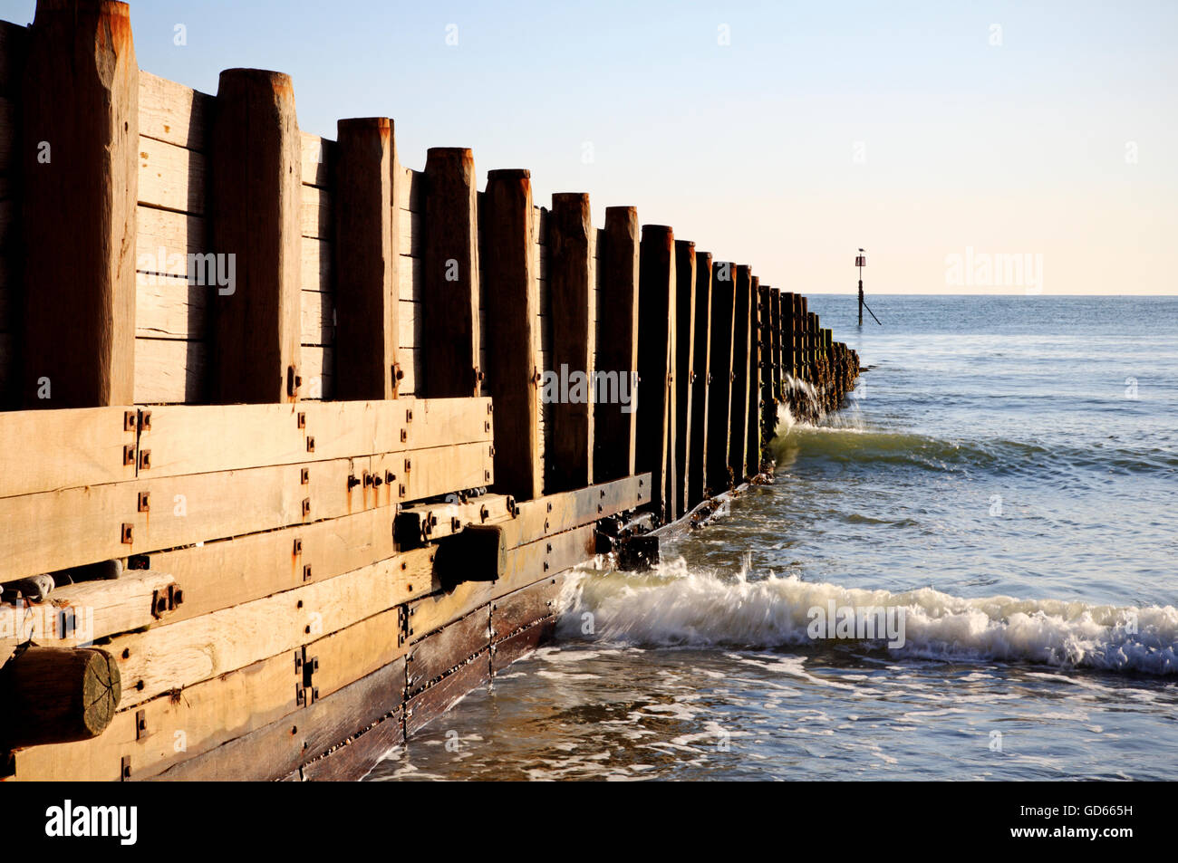 A substantial wooden breakwater on the beach at Cromer, Norfolk, England, United Kingdom. - Stock Image