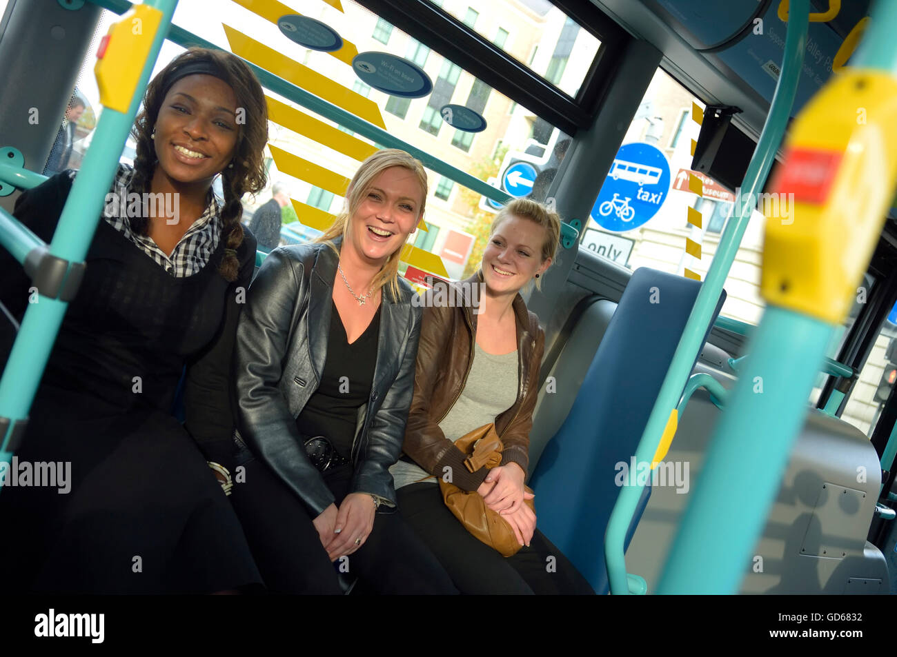 A group of women traveling on a bus. England. UK - Stock Image