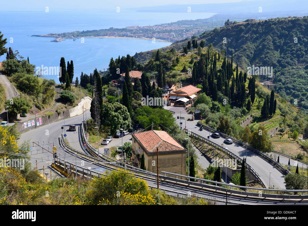 View of winding road leading to Taormina, Sicily, Italy - Stock Image