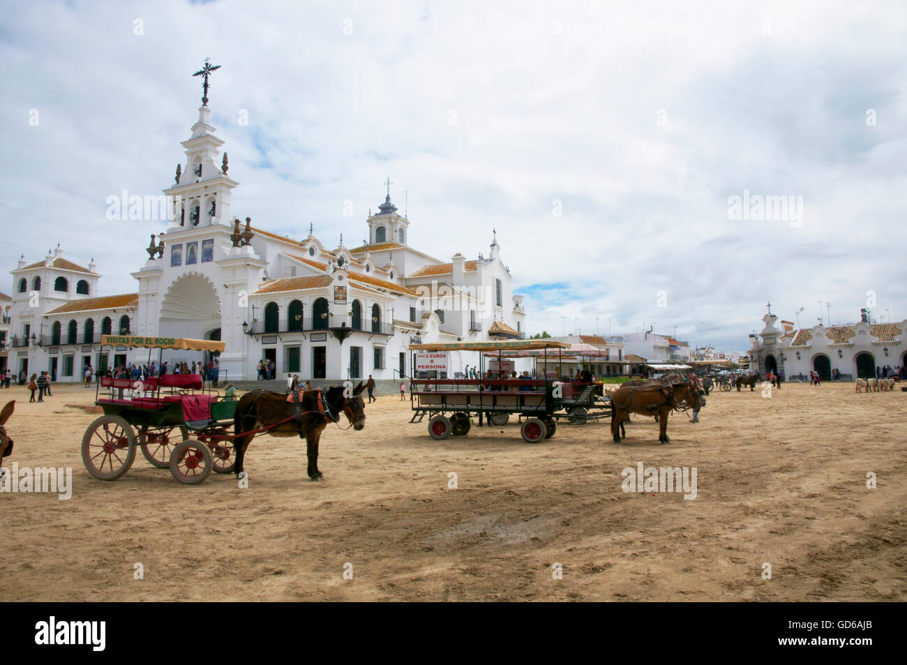 horses and carts awaiting hire in main central area El Rocio. - Stock Image