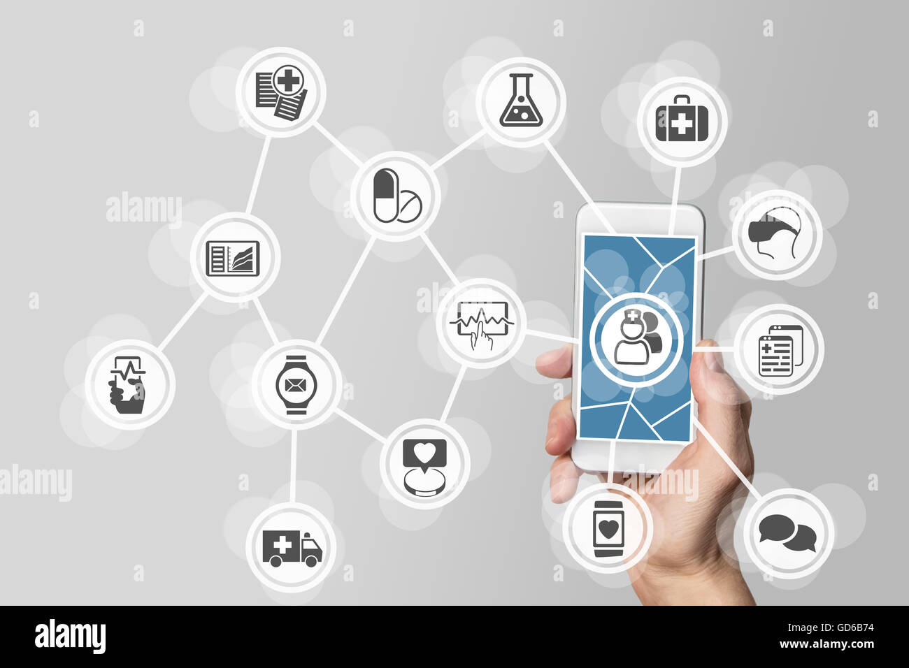 E-healthcare concept with hand holding smart phone - Stock Image