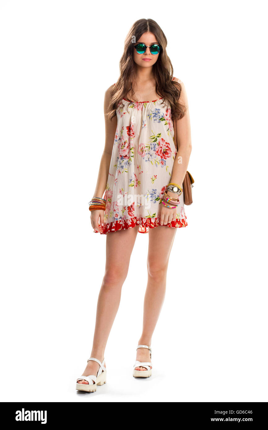Red and white floral print sleeveless dress stock photos red and woman in sleeveless floral dress dark green sunglasses and watch trendy look for summer izmirmasajfo