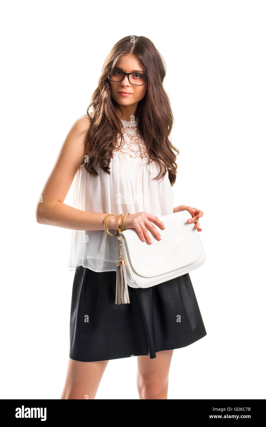 Lady wears blouse with insert. White top and handbag. Attractive girl in glasses. Evening apparel for summer. - Stock Image
