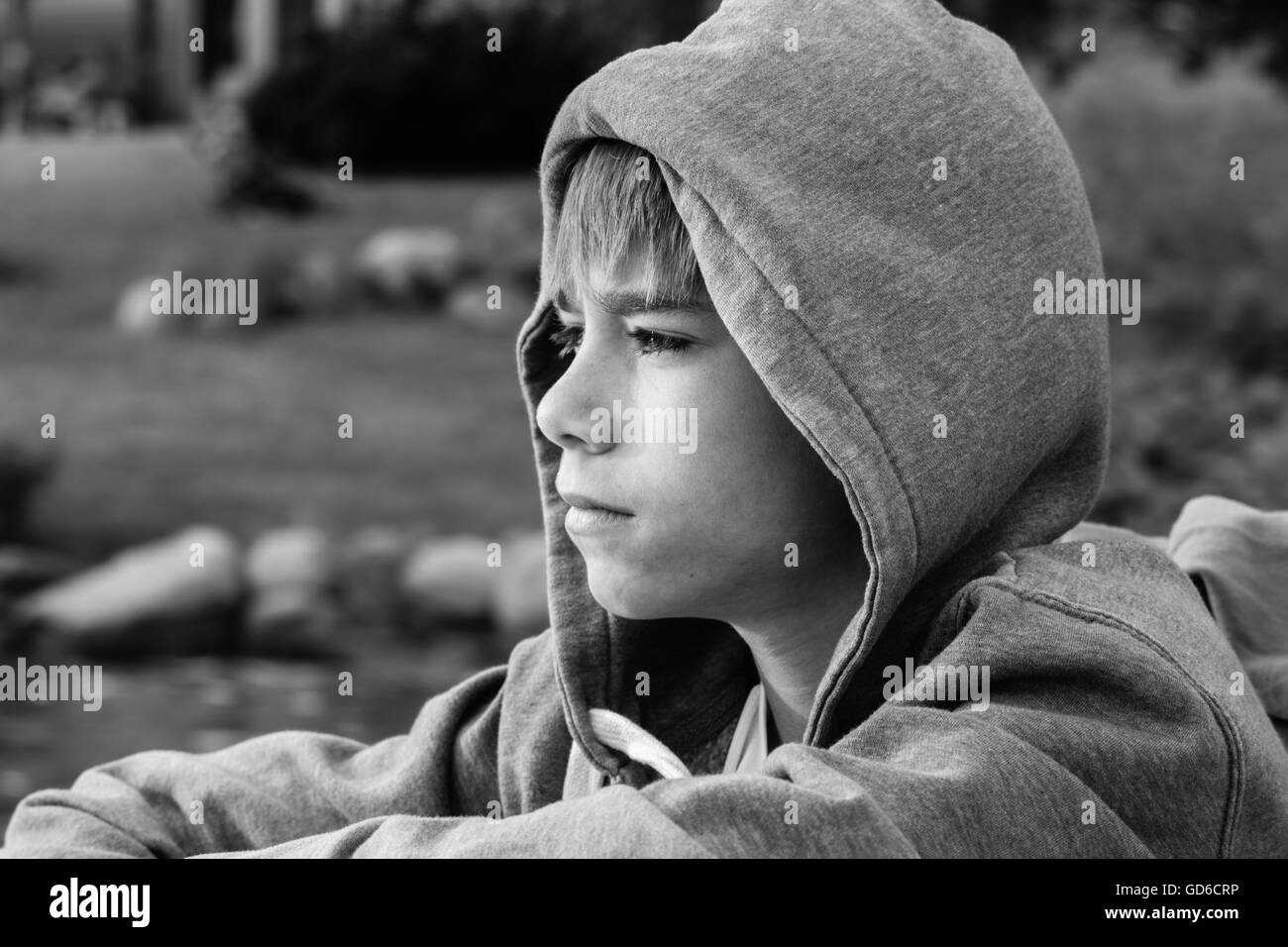 Boy lost in thought Stock Photo