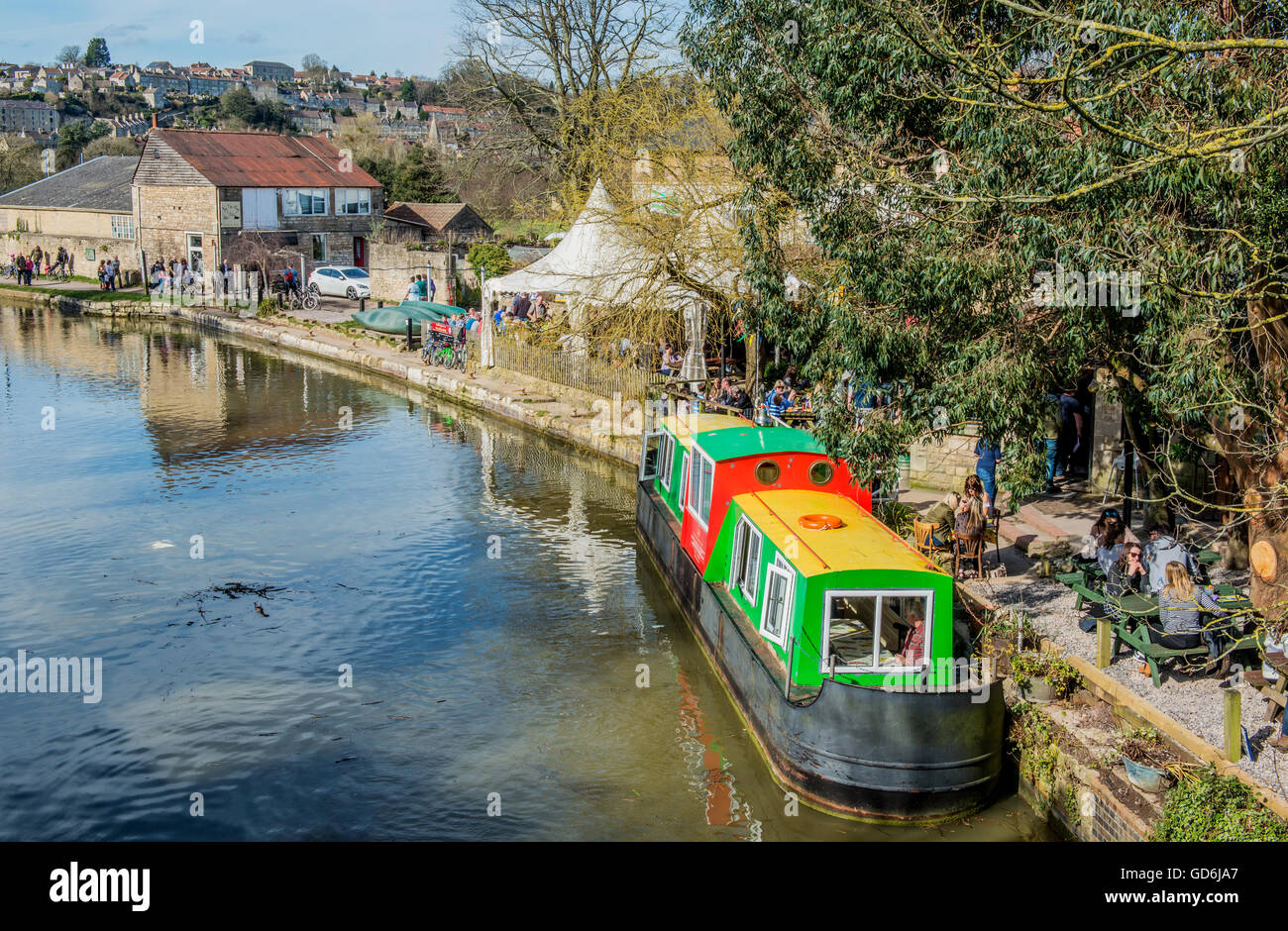 The Kennet and Avon Canal in Bradford on Avon, Wiltshire, showing the canal towpath, people out walking and a moored - Stock Image