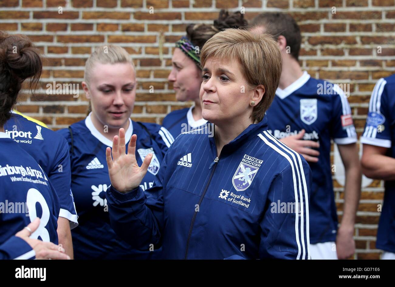 First Minister Nicola Sturgeon wears a Scotland team tracksuit top at the Homeless World Cup in George Square, Glasgow. - Stock Image