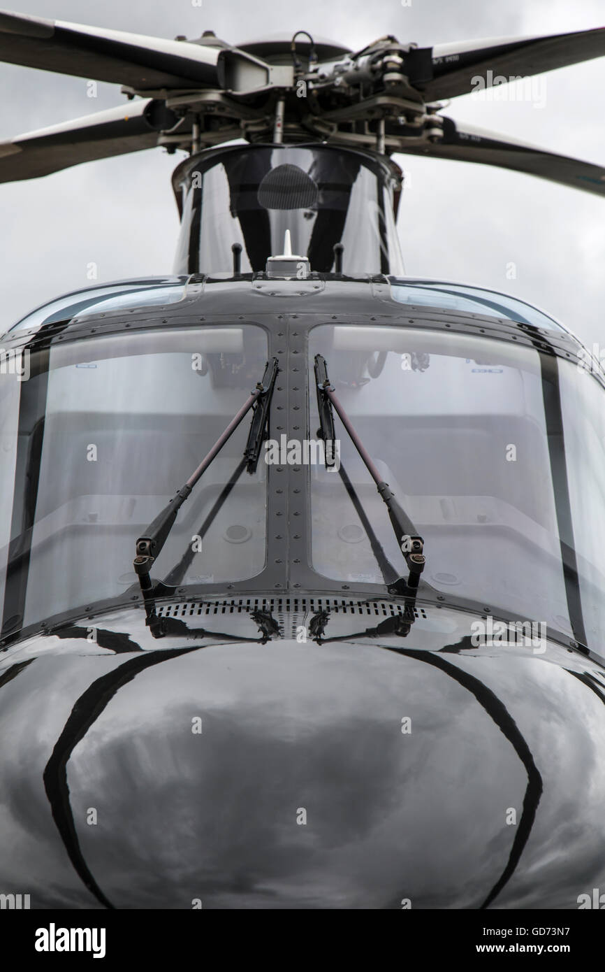 Head on view of the cockpit of an AgustaWestland AW109SP helicopter. - Stock Image