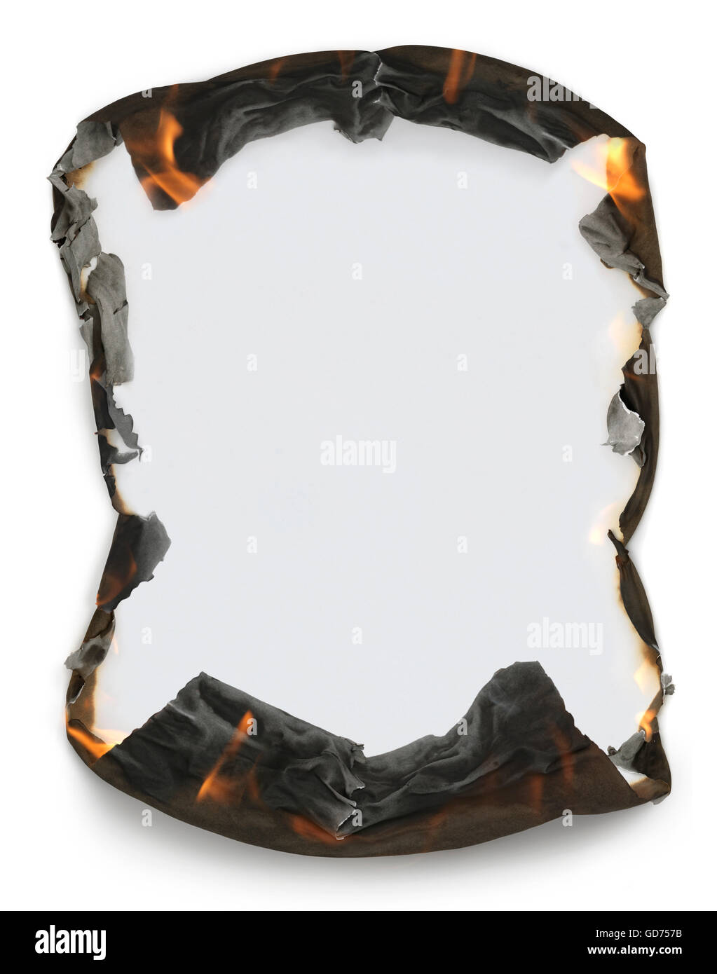 Sheet of blank paper with burning edges making a frame - Stock Image