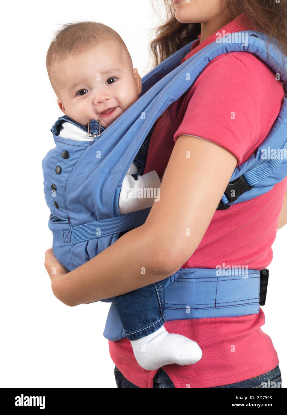 fb527b32f82 Mother with a four month old baby boy in a carrier - Stock Image