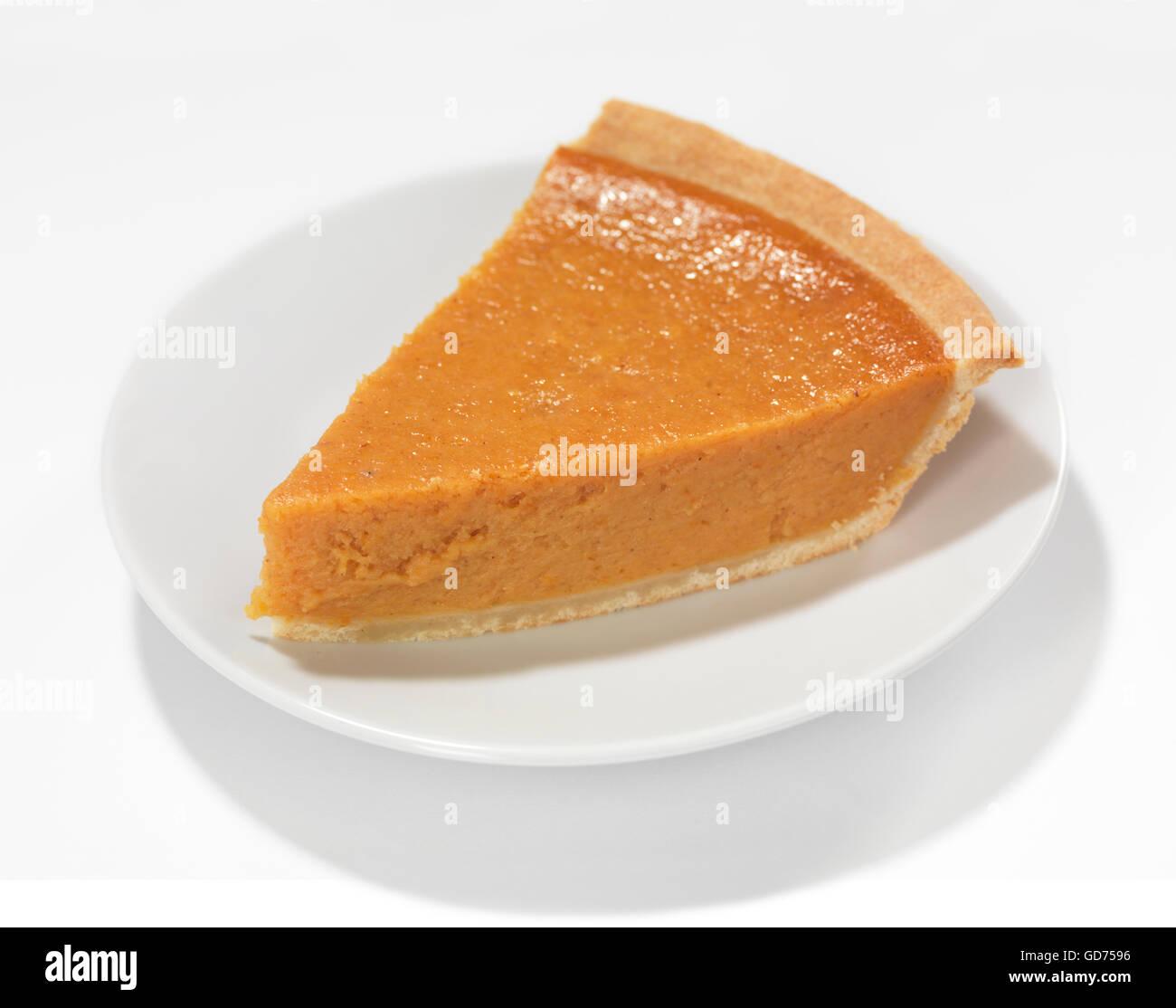 Piece of a pumpkin pie on a saucer - Stock Image