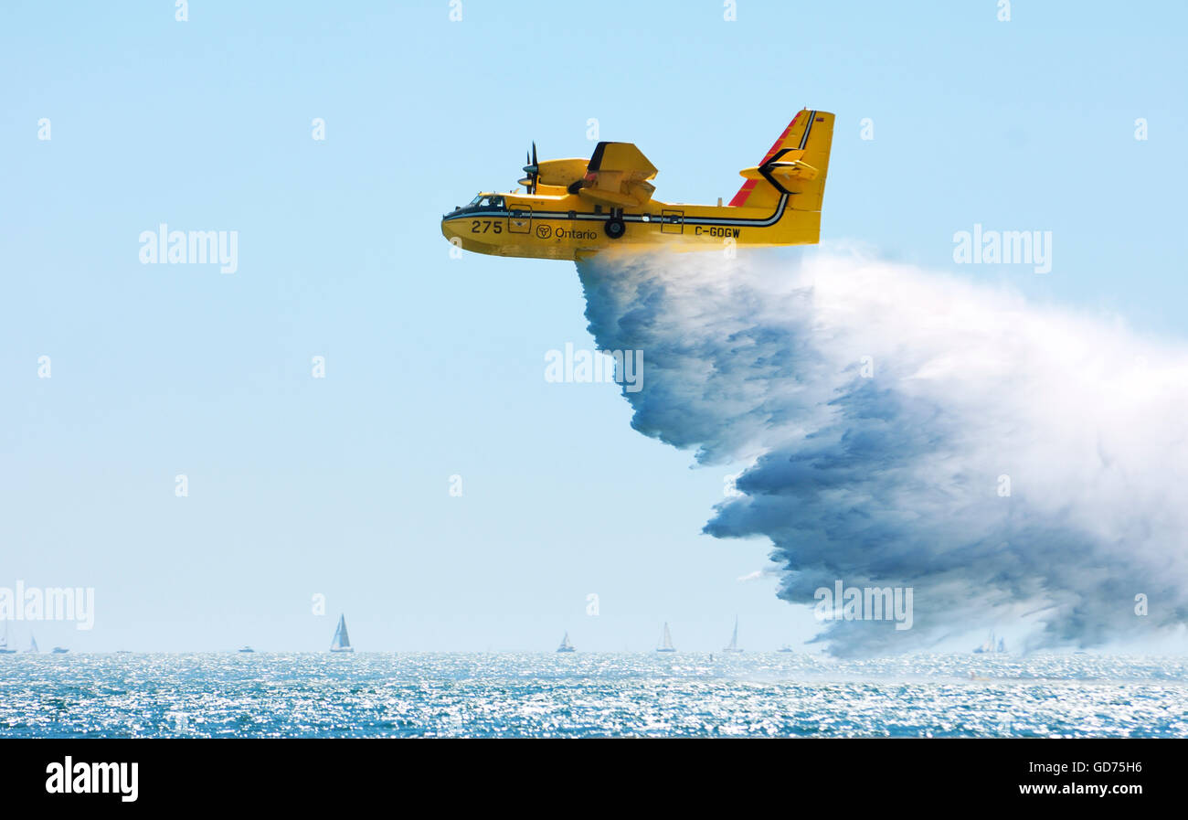 Water Bomber CL-415 firefighting amphibious aircraft releasing water, Canadian International Air Show, Toronto, - Stock Image