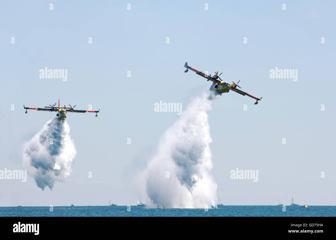 Water Bombers CL-415 firefighting amphibious aircrafts releasing water, Canadian International Air Show, Toronto, - Stock Image
