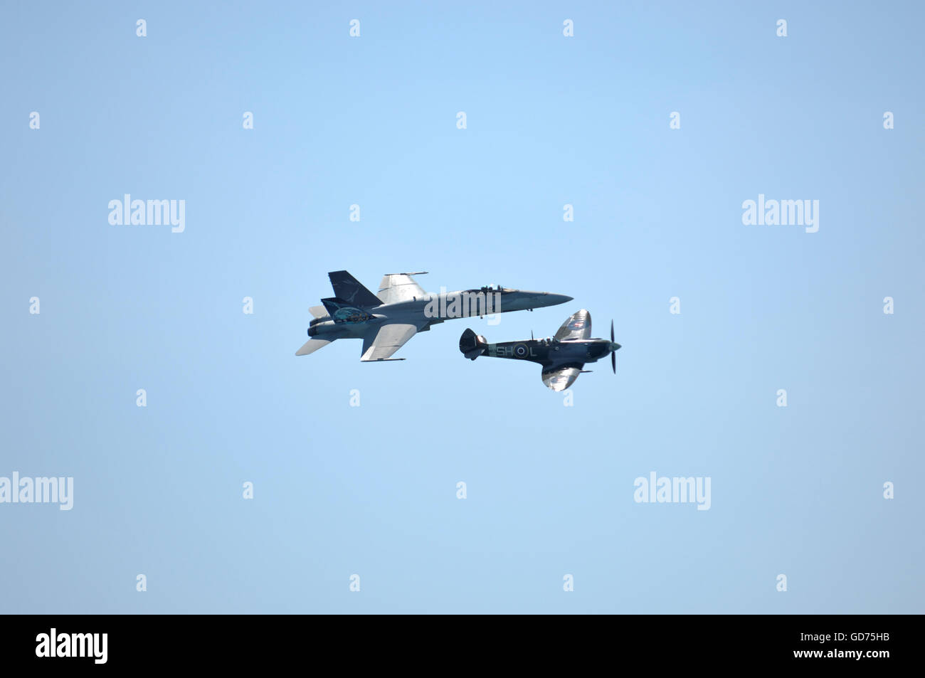 CF-18 Hornet flying at the same speed as Spitfire MK-9 at a close distance, Canadian International Air Show, Toronto, - Stock Image