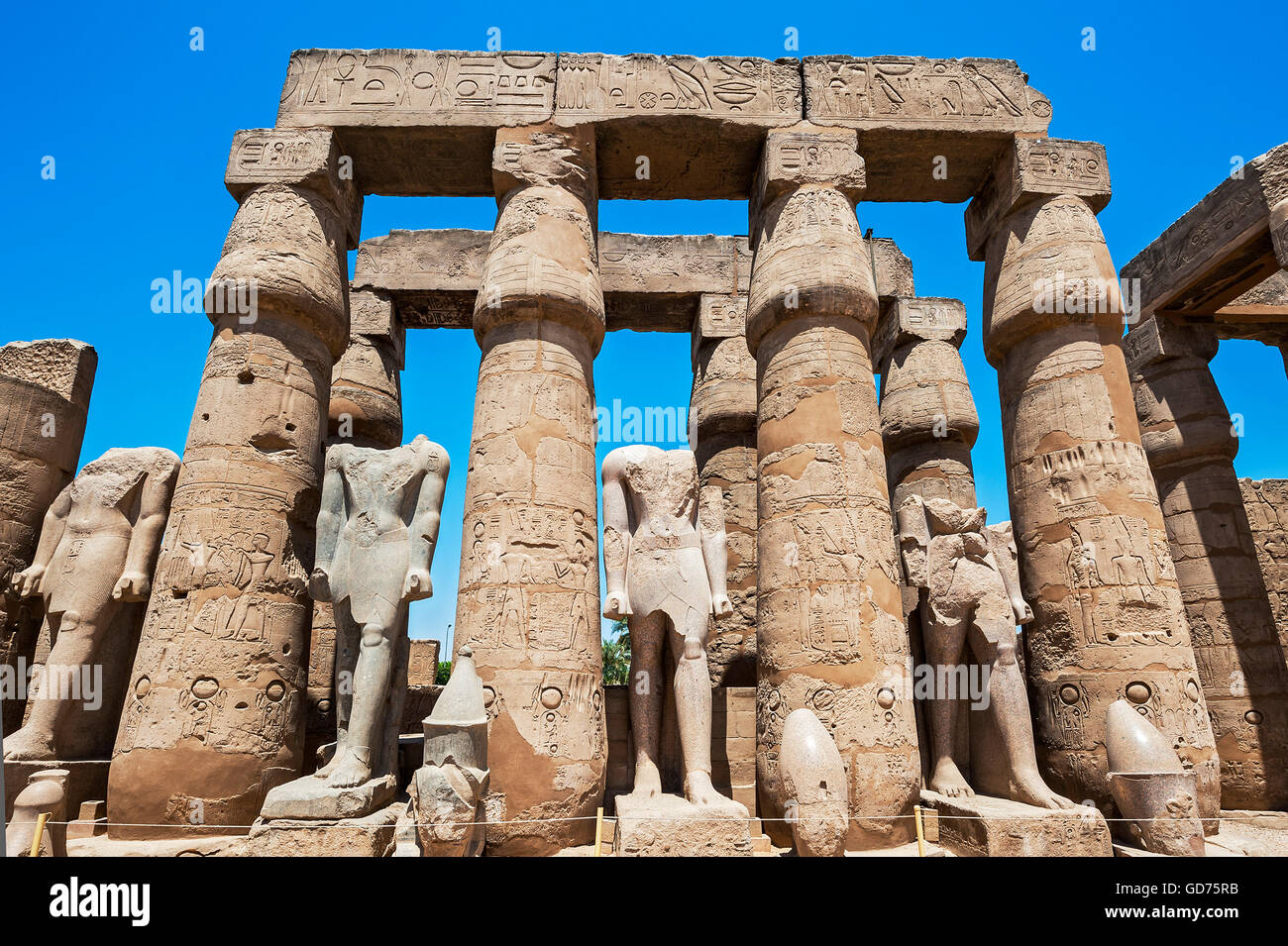 Badly damaged figures, Temple Complex Karnak Temple, Karnak, Luxor, Egypt - Stock Image