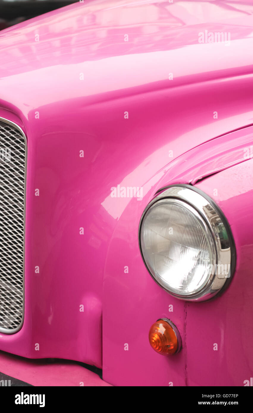 Pink Car Headlight in daylight Stock Photo