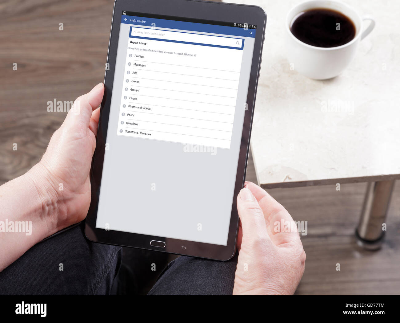 viewing Facebook report abuse page tablet Stock Photo