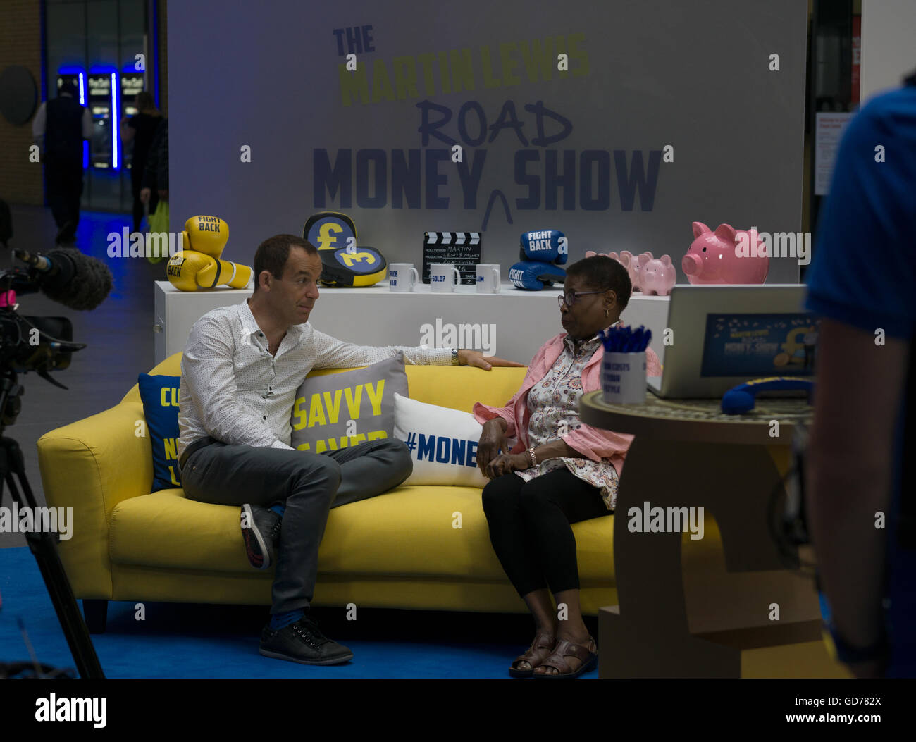 Martin Lewis conducting a live interview on the Money Show film set at Kings Cross St.Pancras Station,London,England Stock Photo