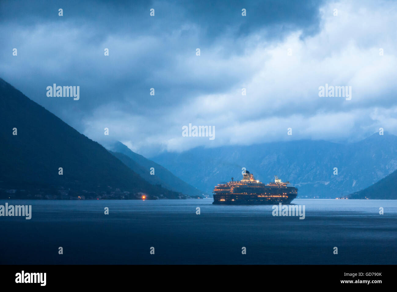 Boka Kotorska (the Bay of Kotor) from the village of Dobrota, Montenegro on a stormy evening: Mein Schiff 2 departing - Stock Image