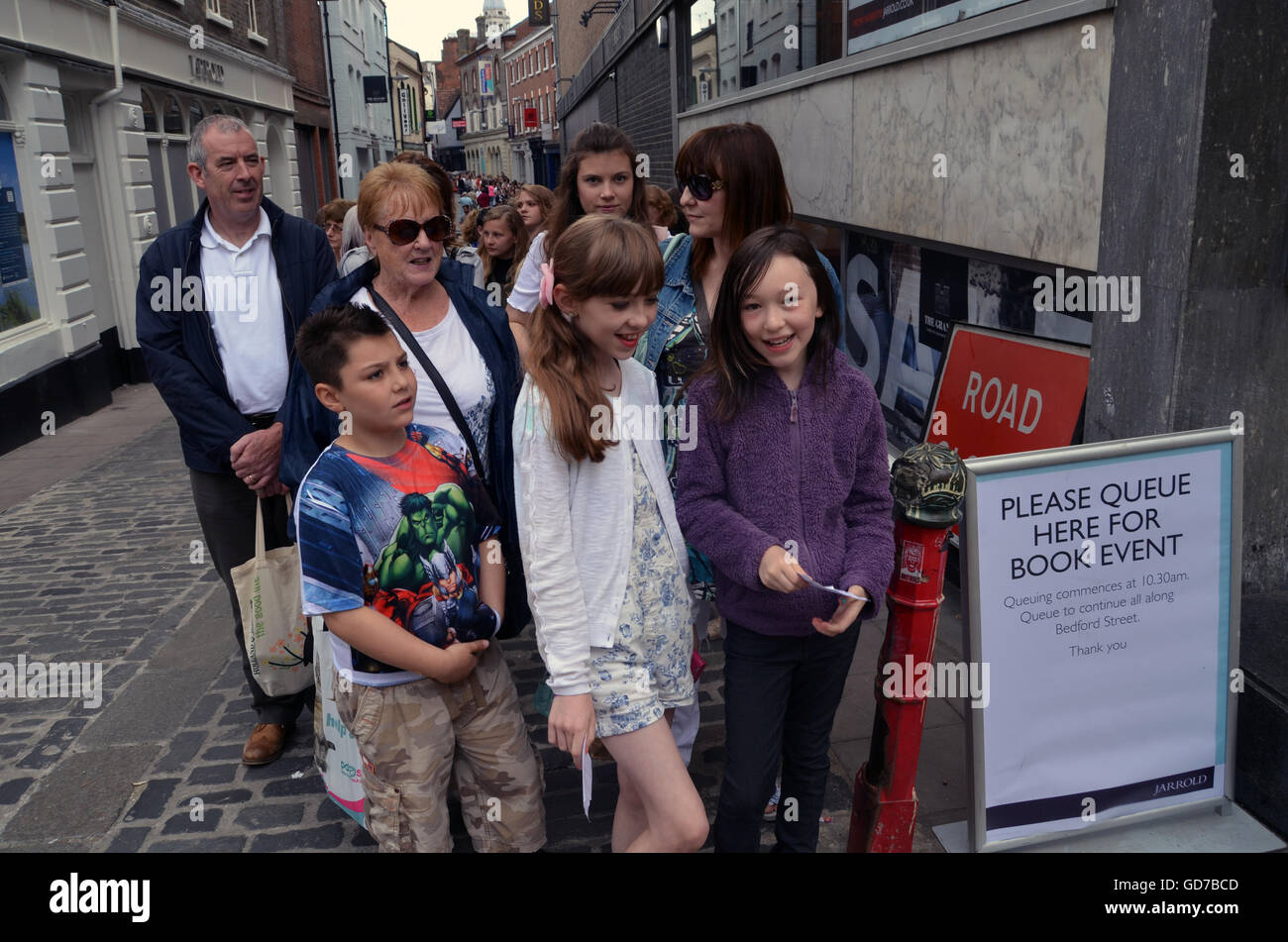 People queuing for Tanya Burr, blogger, book signing outside Jarrolds, Norwich July 2016 UK - Stock Image