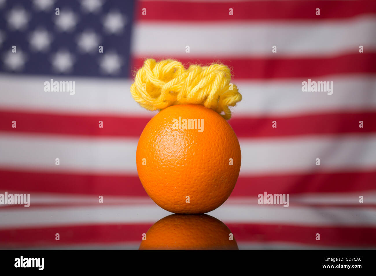 A satirical photo of an Orange made to look like US presidential candidate Donald Trump. - Stock Image