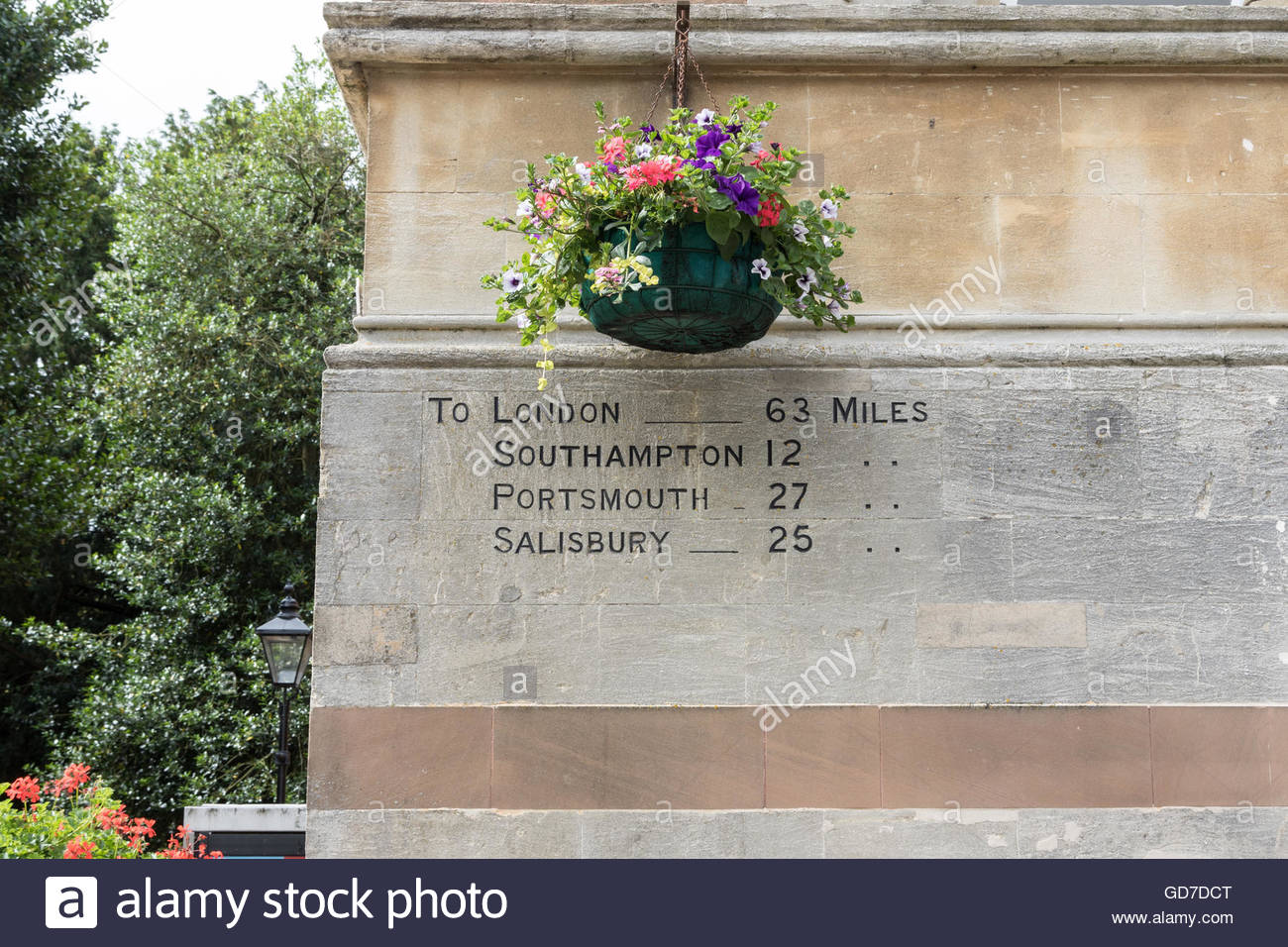 Milestone markers etched into the wall of a building in Winchester, Hampshire, UK - Stock Image