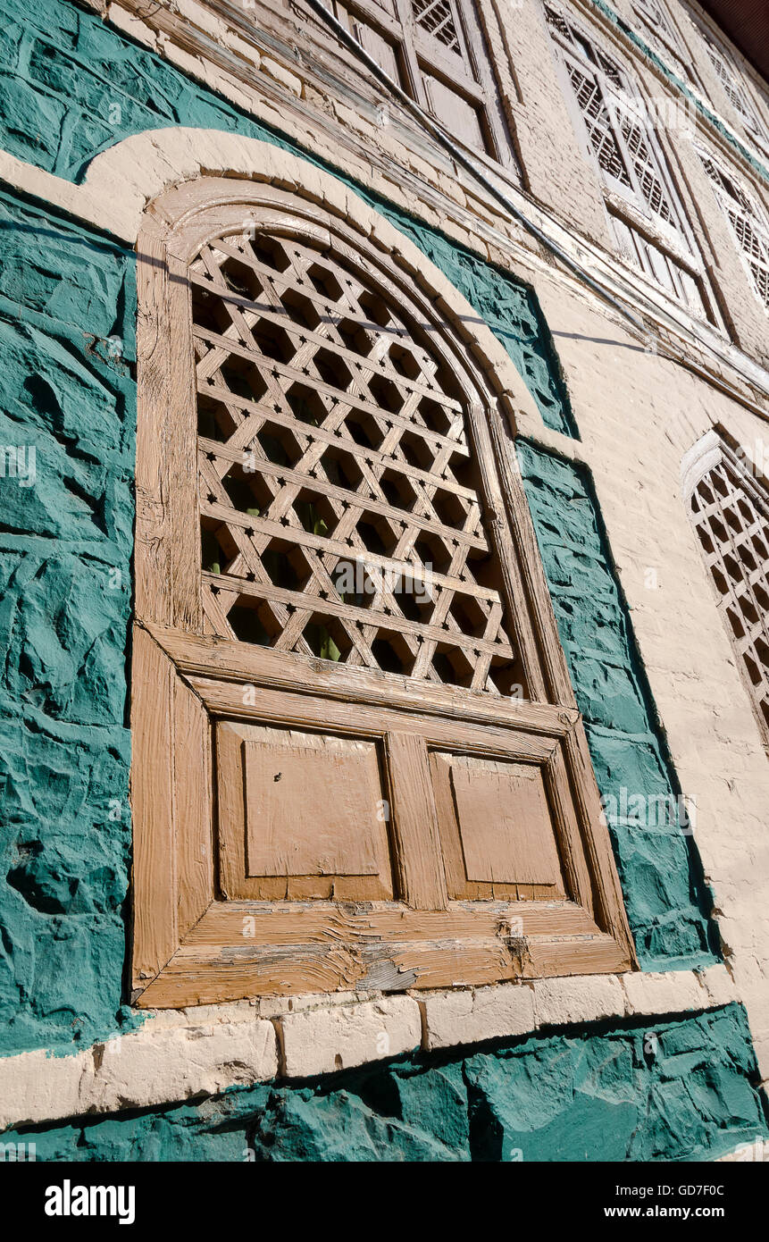 Wooden windows in old stone building srinagar jammu and kashmir india
