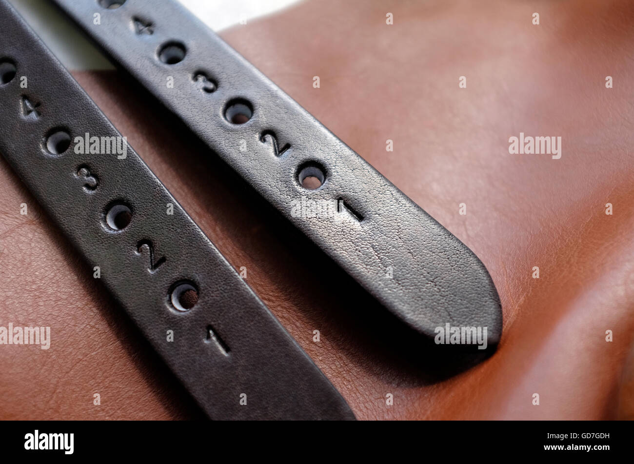 traditional handmade leather saddle making - Stock Image