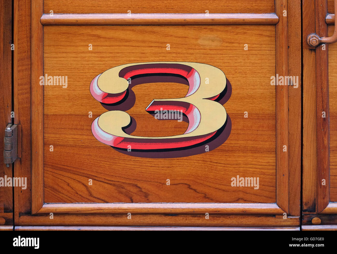 number 3 hand painted on wooden railway carriage - Stock Image