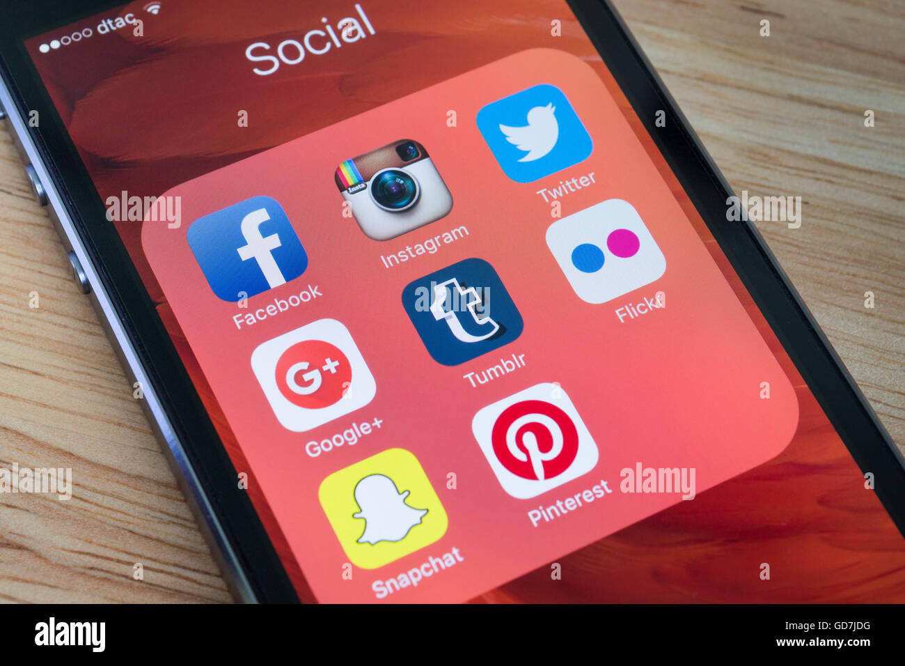 Bangkok, Thailand - December 12, 2015 : Apple iPhone5s showing its screen with popular social network applications. Stock Photo