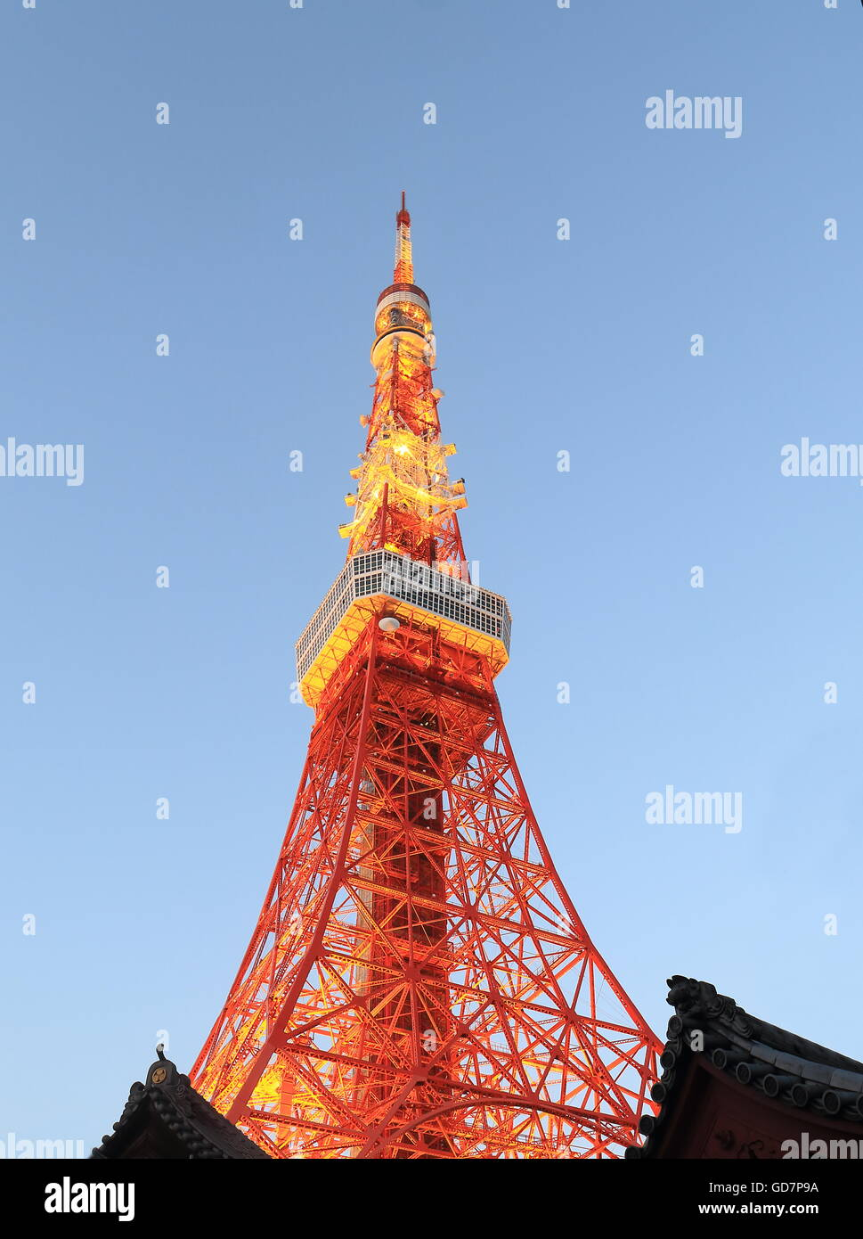 Iconic Tokyo Tower over Japanese kawara roof in Tokyo Japan. - Stock Image