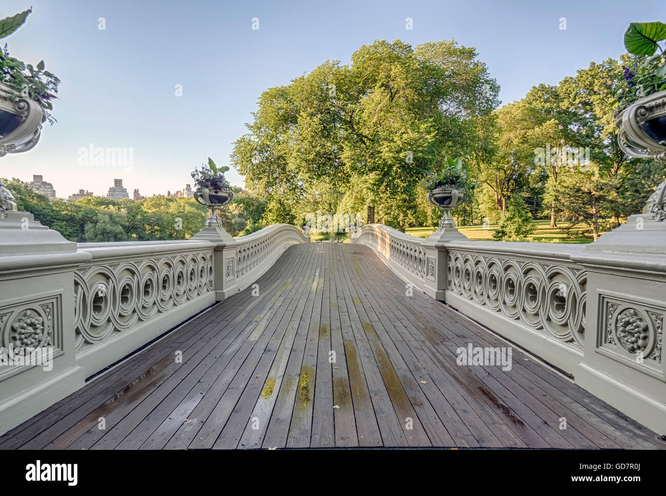 Bow bridge in early morning after summer rain with blue sky - Stock Image
